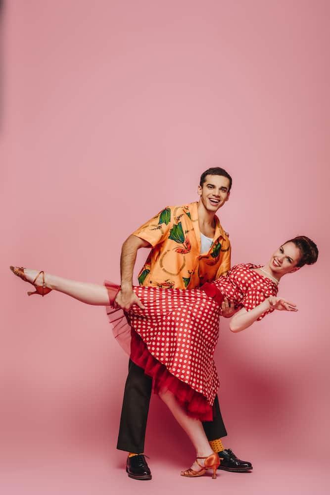 swing dancing couple polka dot dress