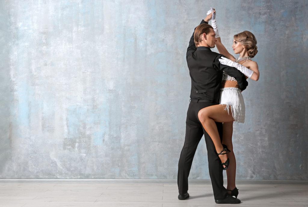 types of salsa dance couple in studio